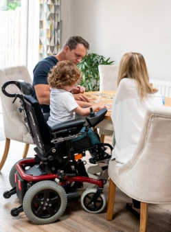 Young girl in wheelchair with family